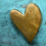 gold heart against a teal background