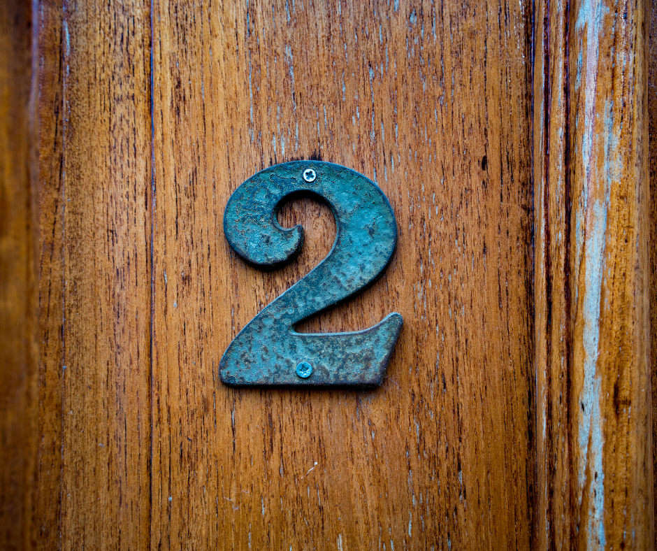 The number 2 on a wood door