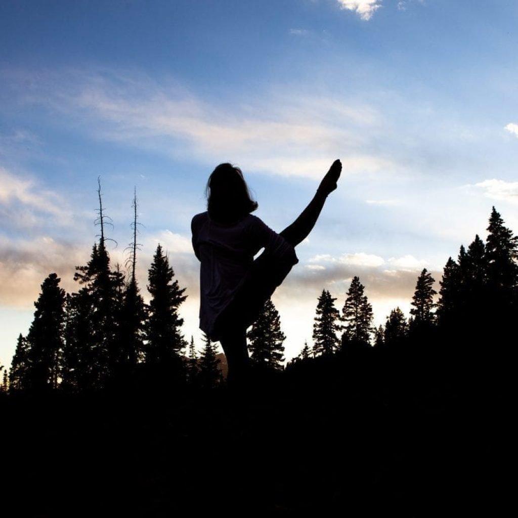 Carin in a balancing pose at sunset