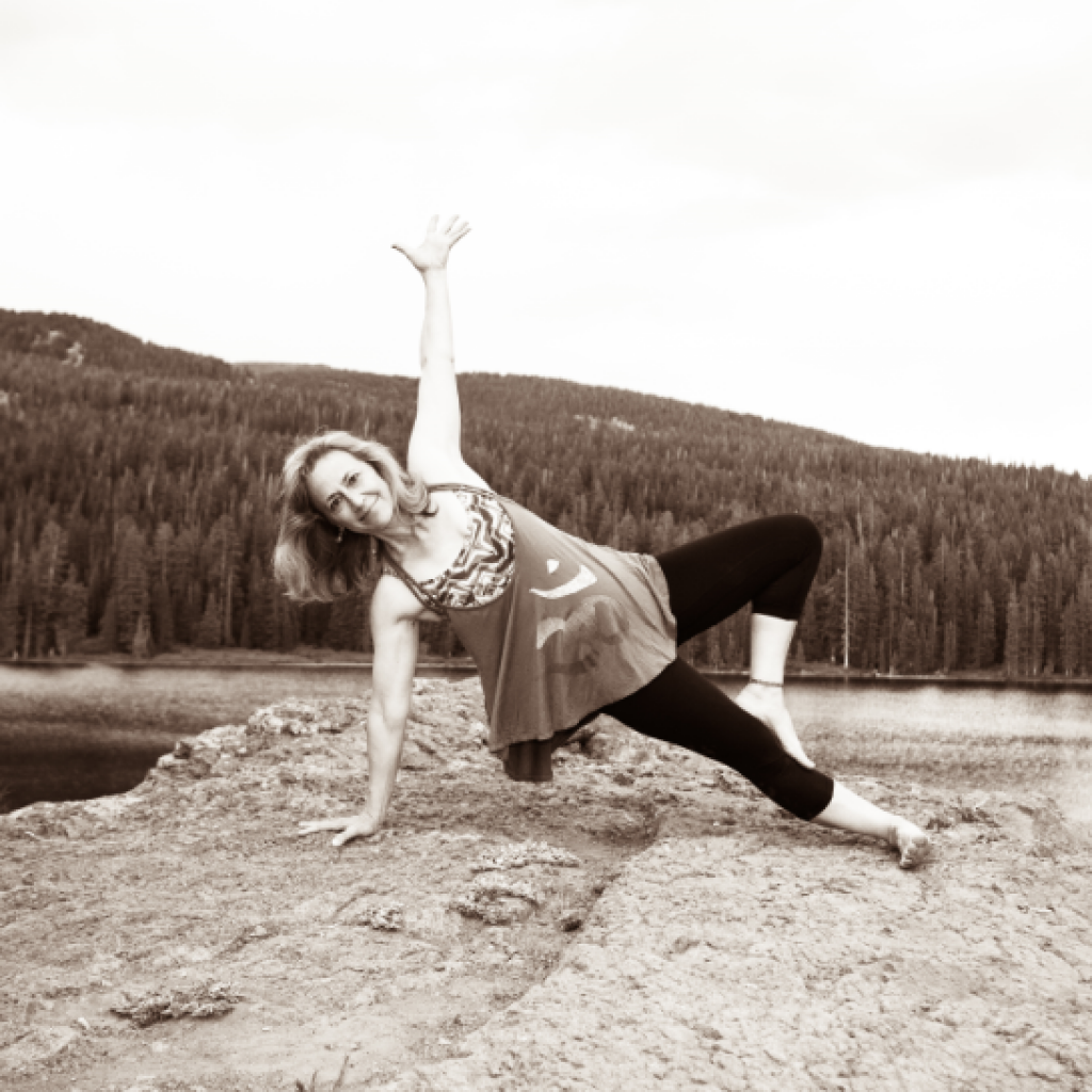 Carin doing side plank on a rock