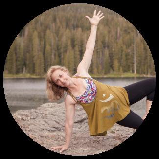 Carin doing a yoga pose at lake Irwin