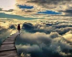 woman walking in the clouds
